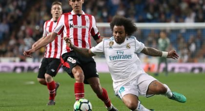 Real Madrid's Marcelo in action with Athletic Bilbao's Ander Iturraspe