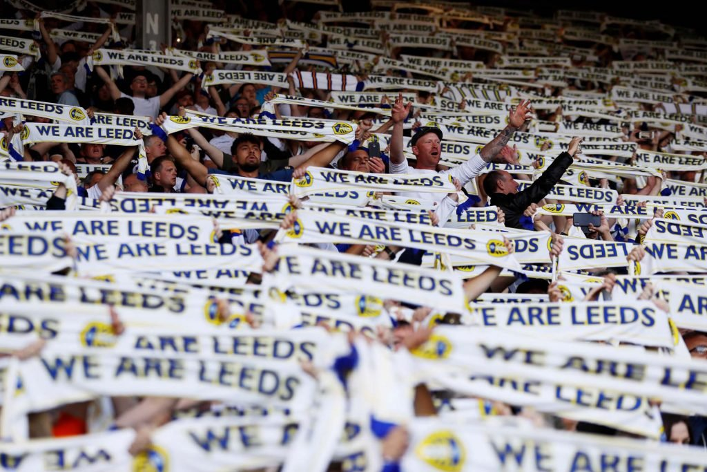 Leeds fans hold aloft scarfs during the game