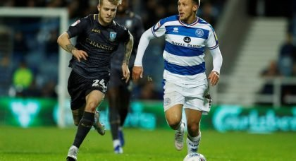 Queens Park Rangers' Luke Freeman in action with Sheffield Wednesday's Ash Baker, October 2018